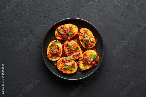 Fotografia, Obraz  Golden Egg Curry in black bowl at dark slate background