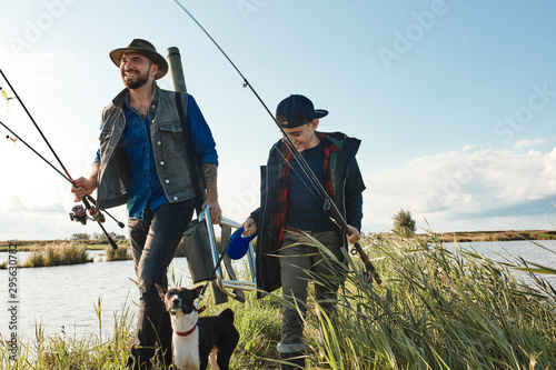 Papiers peints Peche Warm sunny day. Father and son decide to go fish first together to spend time together, to bring fish mom at home like earners.