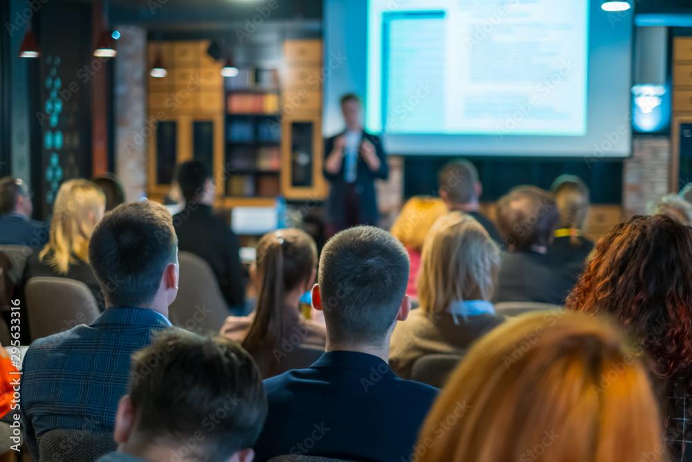 Fototapeta Audience listens lecturer at workshop