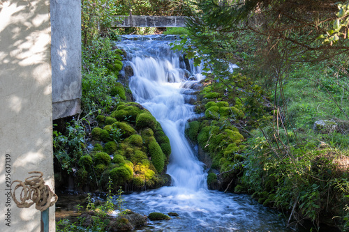 Foto auf Gartenposter Forest river Small waterfall next to the old house in a yard in village Martin Brod in Bosnia and Herzegovina