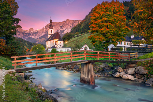 Foto op Canvas Bomen Autumn in Alps. Image of the Bavarian Alps with Parish Church of St. Sebastian located in Ramsau bei Berchestgaden, Germany during beautiful autumn sunrise.