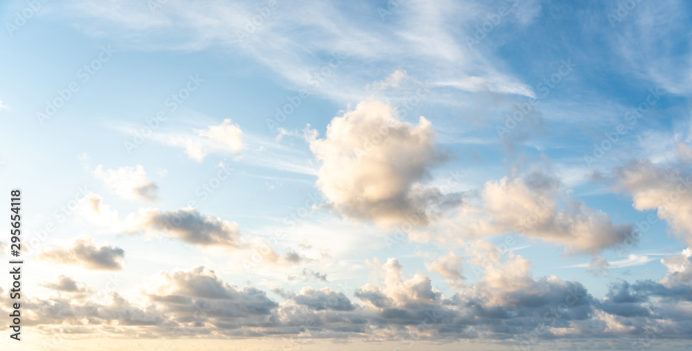 Blue sunset sky with nice white clouds