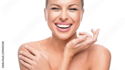 Pinturas sobre lienzo  Happy woman with perfect skin isolated on white background.
