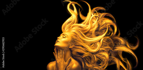 Obraz Gold Woman. Beauty fashion model girl with Golden make up, Long hair on black background. Gold glowing skin and fluttering hair. Metallic, glance Fashion art portrait, Hairstyle. Fashion art design - fototapety do salonu