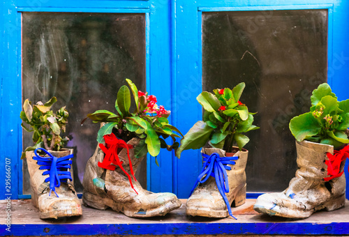 Cute window floral decoration with vintage shoes. Ideas for gardening