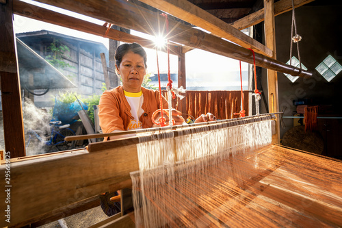 Fotografie, Tablou  Traditional Isan Thai silk weaving