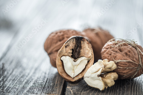 Walnut in open form on a wooden background, close-up . - 295671940