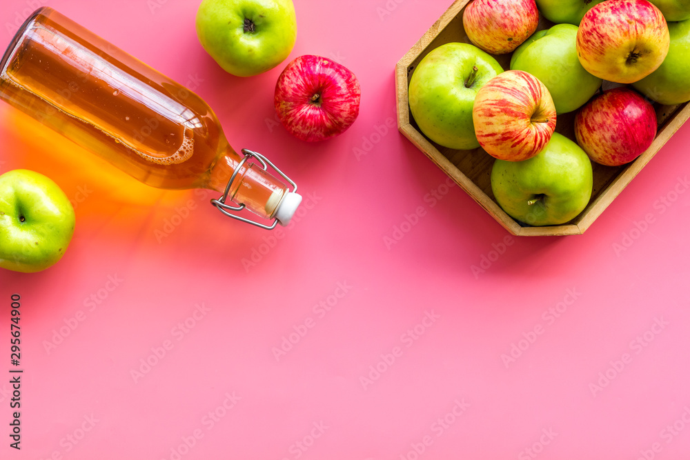 Fototapety, obrazy: Apple cider in bottle near tray with fruits on pink background top view space for text
