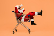 Real Santa Lying In Cart From Supermarket And Looking Away