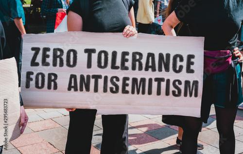 The phrase  Zero tolerance for antisemitism  drawn on a carton banner in hand Tapéta, Fotótapéta