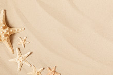 Starfish On Sea Sand. Texture Of Light Sand. Concept Of Beach Holiday. Summer Concept. Flat Lay, Top View, Copy Space