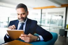 Elegant Business Multitasking Multimedia Man Using Devices