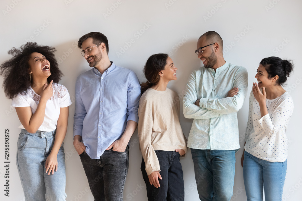 Fototapeta Happy diverse people having fun, talking, standing in row
