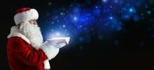 Santa Claus With Magic Book On...
