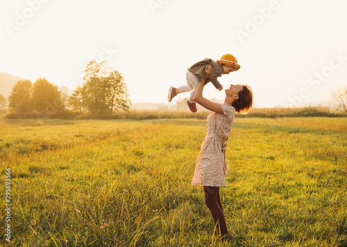 Fotografiet  Mother and baby outdoors. Family on nature.