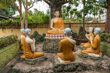 Bang Saen, Thailand - March 16, 2019: Wang Saensuk Buddhist Monastery. Group Of Colorful Sculptures Depicting Buddha Giving His First Sermon On Noble Truths To Five Disciples.