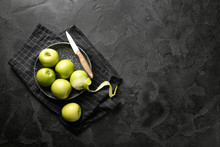 Plate With Fresh Ripe Apples And Knife On Dark Background