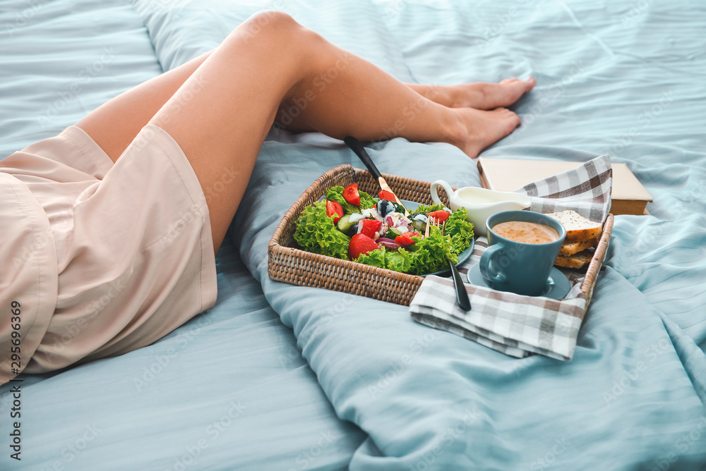 Fototapety, obrazy: Young woman having tasty breakfast in bed