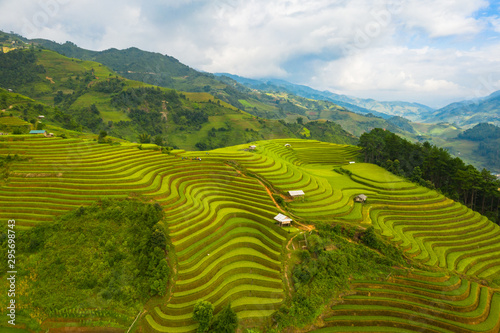 Recess Fitting Rice fields Aerial top view of paddy rice terraces, green agricultural fields in countryside or rural area of Mu Cang Chai, Yen Bai, mountain hills valley at sunset in Asia, Vietnam. Nature landscape background.
