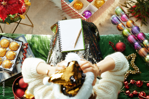 Cuadros en Lienzo stressed housewife tired of holiday bustle in room at Christmas