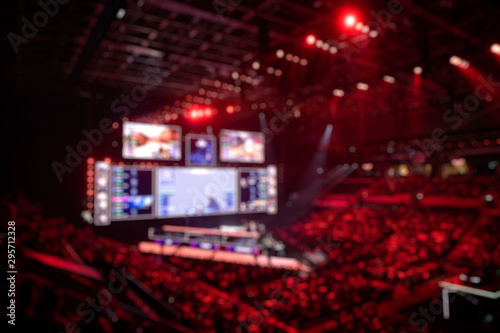 Blurred background of an esports event - Big illuminated main stage of a computer games tournament located on a big stadium Wallpaper Mural