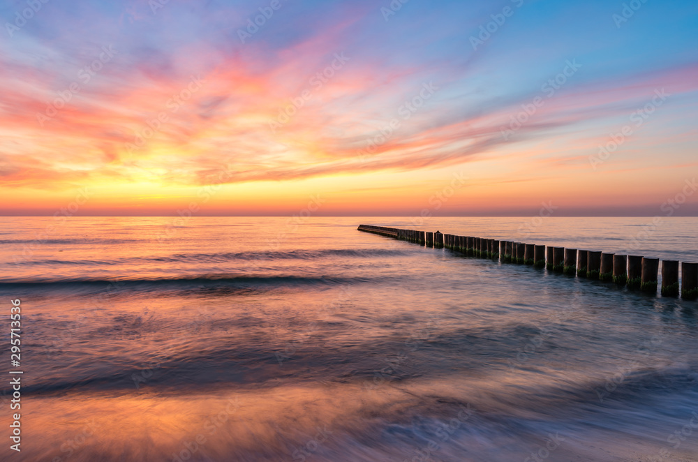 Fototapeta Baltic sea seascape at sunset, Poland, wooden breakwater and waves