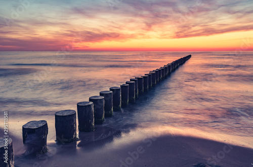 Fototapeten See sonnenuntergang Baltic sea seascape at sunset, Poland, wooden breakwater and waves