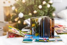 Travel Photo Books Lie Near The Christmas Tree