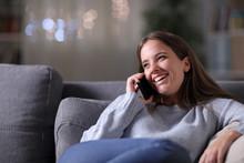 Happy Woman Talking On Phone O...