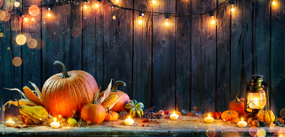 Fototapety, obrazy: Thanksgiving - Pumpkins On Rustic Table With Candles And String Lights