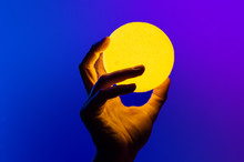 Man Holding Yellow Moon Shape ...