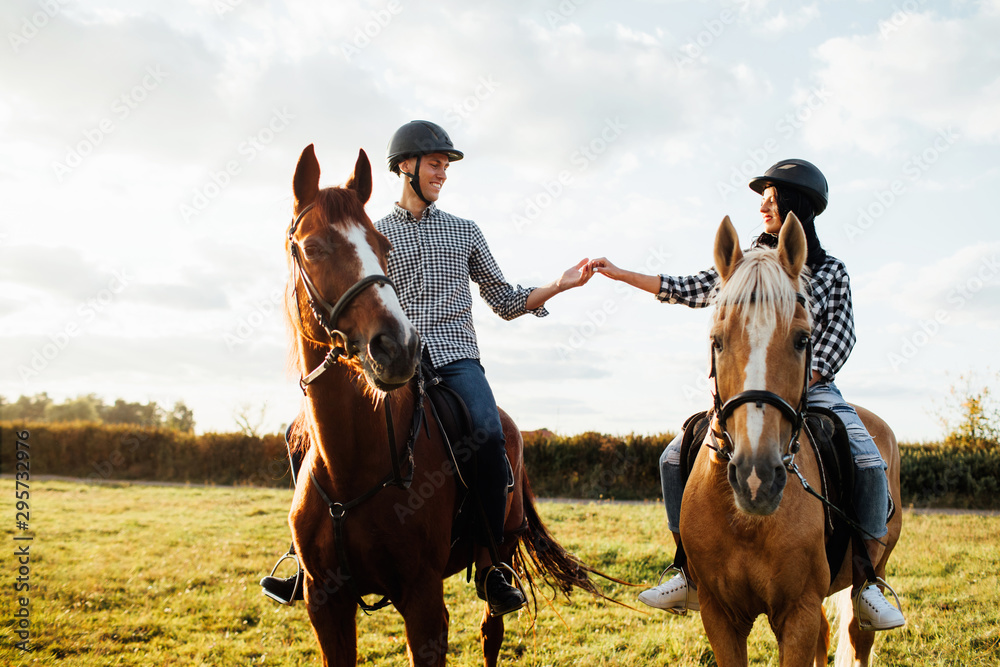 Fototapety, obrazy: Portrait of happy loving couple spending time with horses on ranch