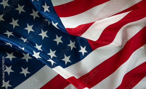 Fotografía  Close-up of ruffled American flag, light painted background - USA