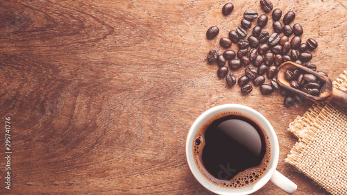 Canvas Prints Cafe top view coffee bean and wooden scoop and a cup of coffee on wood table