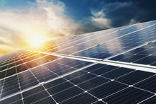 Solar Panel With Blue Sky And Sunset. Concept Clean Energy, Electric Alternative, Power In Nature