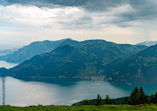 Fototapeta Switzerland, Panoramic view on green Alps and lake Lucerne near Gersau village obraz na płótnie