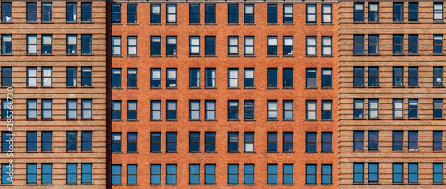 Wall Murals New York Banner and cover scene of Brown Brick high building facade with windows in New York City, United states of America, USA, Industrial Background and texture, Loft inspiration. Construction facade,