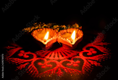 two glowing terracotta lamps against dark background in Diwali concept Canvas Print