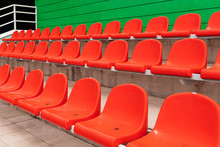 Rows Of Red Diagonal Spectator Seats With No People In It