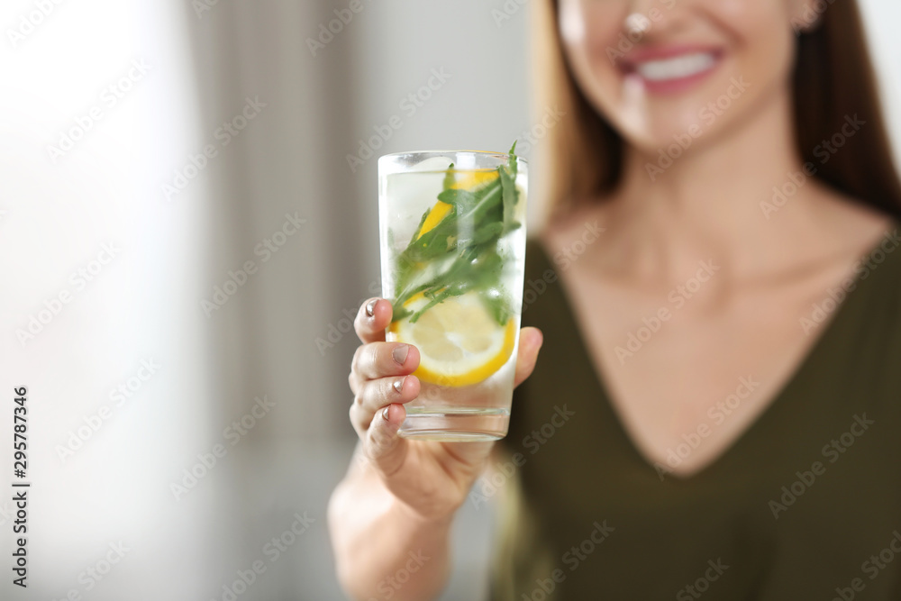 Fototapeta Young woman with lemonade at home, closeup. Refreshing drink