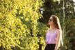Leinwandbild Motiv Beautiful young woman in park on sunny day