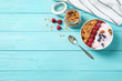 canvas print picture - Tasty homemade granola served on blue wooden table, flat lay with space for text. Healthy breakfast