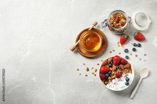 Fototapeta Tasty homemade granola served on marble table, flat lay with space for text. Healthy breakfast obraz na płótnie