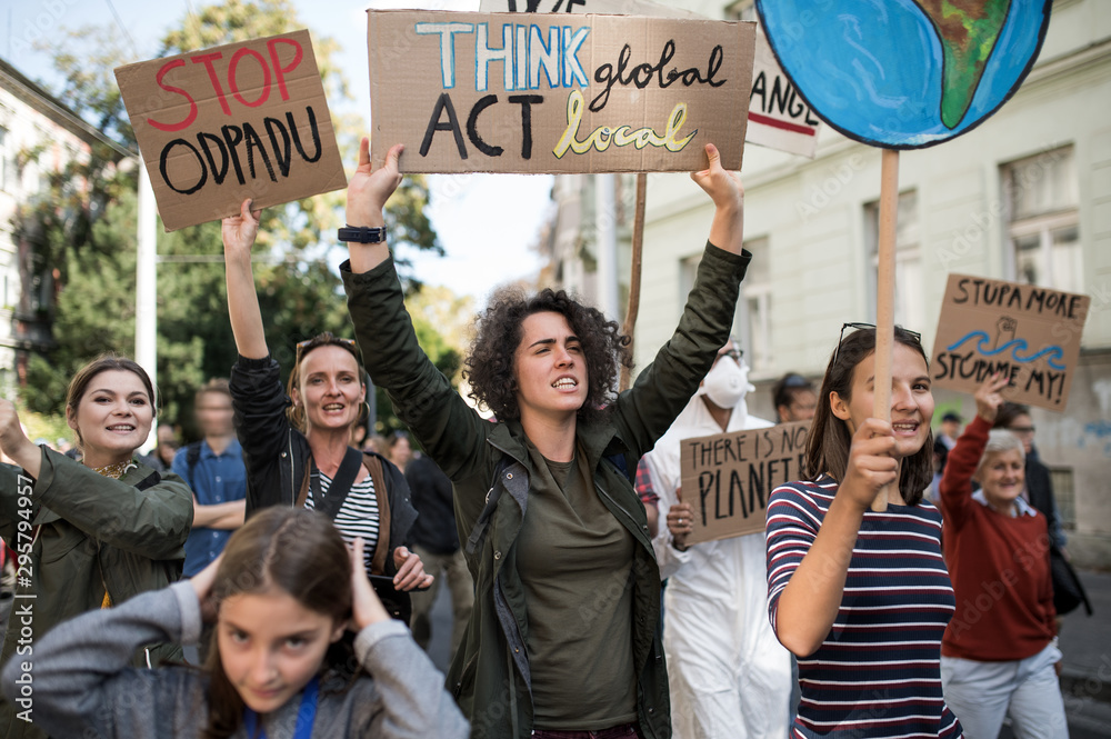 Fototapety, obrazy: People with placards and posters on global strike for climate change, shouting.