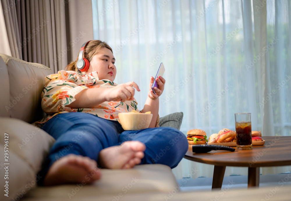 Fototapety, obrazy: plump fatty woman hunger enjoy eating a lot junk food with high calories beverage drink and snack eating in the same time
