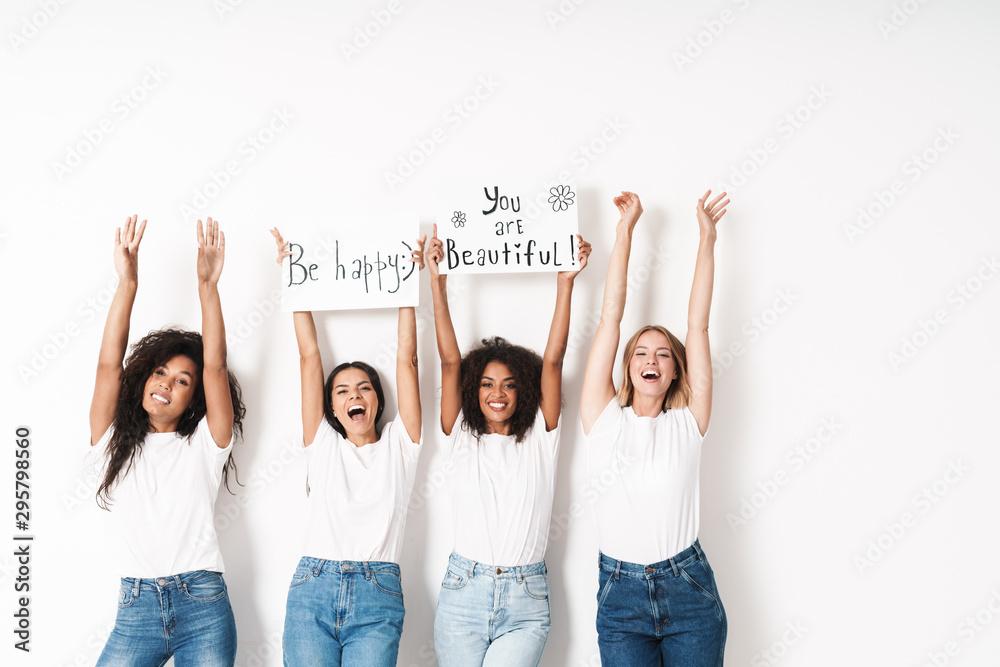 Fototapeta Positive young women multiracial friends