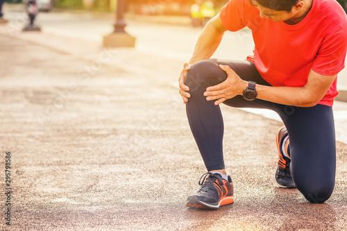 Runner man with sports running knee injury Canvas Print