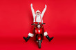 canvas print picture - Portrait of his he nice attractive carefree crazy bearded cheerful cheery funny funky Santa riding bike delivering orders having fun isolated over bright vivid shine vibrant red color background