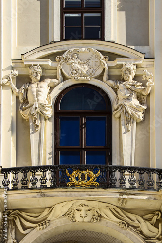 A fragment of the facade of the building is a balcony with an openwork metal fen Wallpaper Mural