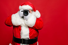 Portrait Of Focused Elderly Santa Claus Hipster Take Photo Of His Christmas Time Voyage Abroad Wear Stylish Costume Belt Gloves Isolated Over Red Background